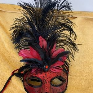 Black and red Mardi Gras mask